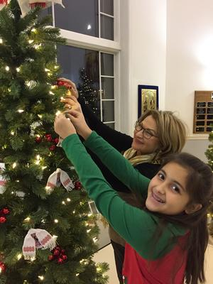 UHEC fans decorating Christmas tree