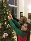 UHEC fans decorating Christmas tree